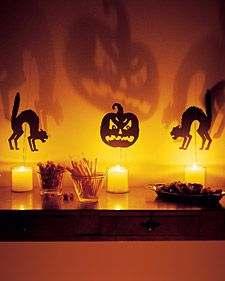 DIY Shocking Silouettes for Candles- As day turns to night, call on candles to cast an eerie glow throughout your home. When fierce silhouettes are propped above them, spectacular shadows dance across the walls.
