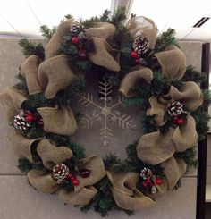 Burlap evergreen winter Christmas wreath. From google search.