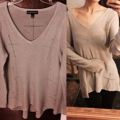Lightweight gray sweater. Never worn. Never worn. Light weight and pretty with gentle cross designs. Sweaters
