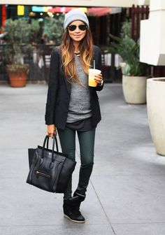 black skate shoes outfit. With a grey beanie and matching t-shirt, layers, green pants, black blazer, black purse.. aviator sun glasses.