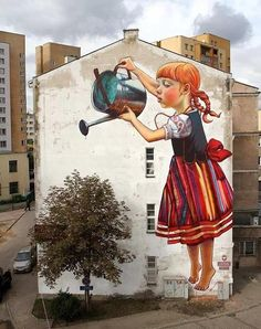 Street art, girl with water can, girl watering tree.