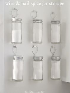 Hang spice jars on the wall with wire for easy access. | 21 Adorable DIY Projects To Spruce Up Your Kitchen