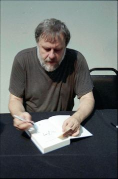 Zizek signing my copy of Living in End TImes.