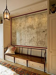 A giant map print and clever storage feature in this London town house hallway designed by Max Rollitt. www.maxrollitt.com