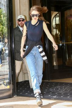 Combat boots: Gigi  plumped for comfort with a pair of Velcro finished shoes...