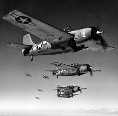 Grumman F4F Wildcat fighters of the U.S. Navy in formation over the Pacific during WWII.