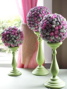 How to Host a Brunch Wedding Shower: Topiaries don't have to be made of greenery. Get playful and creative with buffet or table centerpieces with candlestick-and-lollipop topiaries. To make these, pick up candlesticks in similar shapes of various sizes (large, medium and small). Spray-paint them with one of the colors in the party's aesthetic. Next, edit lollipops down to a cohesive group of colors, and insert them into a floral foam sphere, evenly spaced apart. Place the sphere atop the cand...
