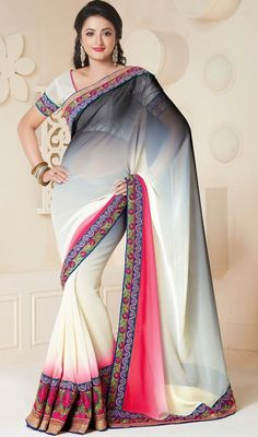 Designer black and off white embroidered chiffon, georgette sari is planned as shaded sari with floral inspired motifs. The sari is ornamented with golden woven lace and silk thread embroidered floral borders which makes you center of attraction of everybody's eyes. Sari comes with matching stitched blouse as shown in the picture. #LatestEveningWearSarees