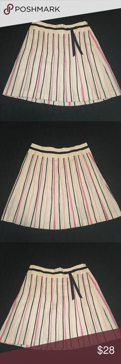 Ann Taylor LOFT Linen skirt. NWT 🌺 Size 8 Beautiful light cream linen skirt. Fully lined with subtle pleats. Pink, black stripes with delicate ribbon bow sitting to side. NWT Ann Taylor Loft Skirts