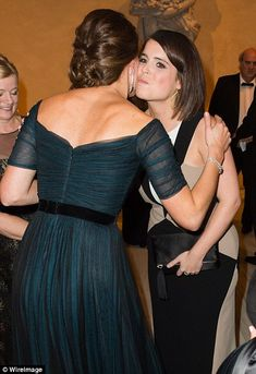 Another royal: Guests at the event included Princess Eugenie (pictured being greeted, left, and kissed on the cheek, right, by Kate)