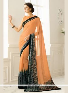 This brilliant array will make you the ultimate classic beauty at the next event you attend. Create a smoldering impact by this peach georgette printed saree. This ravishing attire is amazingly embroi...