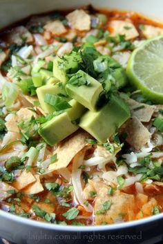 Chicken Tortilla Soup - made with chicken or turkey, cilantro, onions, garlic, jalapeños, tomatoes, spices, stock, lime juice and served with monterrey jack cheese, tortilla chips, and avocado.