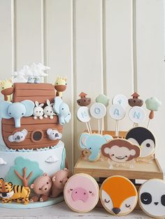 We're not absolutely sure with the accuracy of the zoology of Noah's ark, but we couldn't help but do an entire zoo for this cake set. Noahs Ark Cake, Noahs Ark Party, Baby Shower Decorations For Boys, Baby Decor, Baby Boy 1st Birthday, 1st Birthday Parties, Cake Designs For Kids, Baby Party, Baby Boy Shower