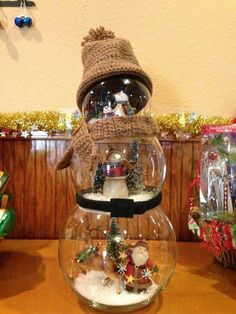 Love that idea: DIY Fishbowl Snowman; What you'll need Fishbowls, fake snow, enamel lid or something else for a hat, embellishments of your choosing
