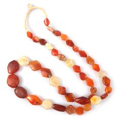 A strand of ancient carnelian, quartz and rock crystal tabular diamond-shaped beads.Beads have been ...
