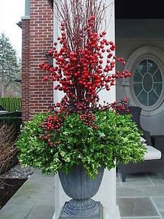 30 Lovely Fall Planters Ideas for Your Outdoor Greenery Plants decoration combined with red flowers This image has get. Christmas Topiary, Christmas Planters, Fall Planters, Christmas Porch, Noel Christmas, Outdoor Christmas, Winter Christmas, Outdoor Planters, Boxwood Planters