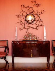 Traditional design details has a warm and pretty shade of watermelon pink on the walls