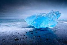 Glacier LagoonPhotograph by Joshua Holko, My ShotDuring one of my last few days in Iceland I drove back to the Jökulsárlón glacier lagoon and the nearby black-sand beaches to see if any fresh icebergs had washed ashore, as indeed they had. This iridescent blue iceberg, polished by the waves, was beautifully backlit and was glowing from within when I set up my tripod and took this photograph.(This photo and caption were submitted to My Shot.)