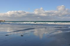 Clouds and reflection at Sennen beach