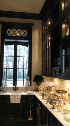 Black cabinets cream walls Tassels Twigs and Tastebuds: Blog it Forward Series ~ The Enchanted Home