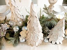 """From the Decorated Home:  """"DIY - Little white glittered Christmas trees made cardboard cereal box. So pretty. Tutorial given how to make your own."""""""