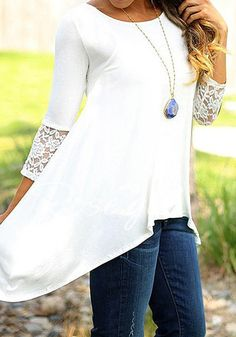 This white lace split-back top is stretchable yet loose fitting and comes with a crew neckline, 3/4 sleeves, an asymmetric hem and lace cuffs in the sleeves. Own one here.   Lookbook Store Tops