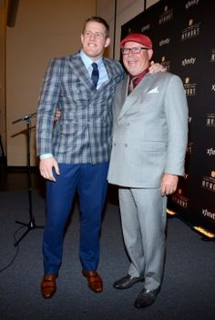 J. J. Watt of the Houston Texans, winner of the AP defensive player of the year award, left, and Bruce Arians, head coach of the Arizona Cardinals, winner of the AP Coach of the Year award, pose in the press room at the 4th annual NFL Honors at the Phoenix Convention Center Symphony Hall on Saturday, Jan. 1, 2015. (Photo by Tonya Wise/Invision for NFL/AP Images)