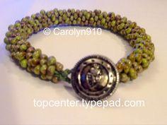 http://topcenter.typepad.com/blog/2014/03/buttonhole-your-braid.html