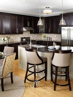 Love the neutrals with the dark wood. Great backsplash too.