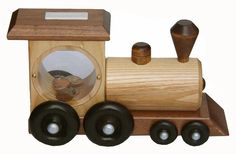 Woodworking Training Amish Loco Musical Train Bank - Amish Train Bank Solid Wood Crafts and Toys Collection This bank is perfect for the little one learning how to count their pennies! Decorate the nursery or playroom with an Amish handmade bank, Wooden Toy Train, Wooden Toys, Woodworking School, Diy Woodworking, Small Oak Table, Wooden Piggy Bank, Wooden Planter Boxes, Cleaning Wood, Wooden Gifts