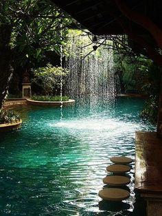 Pool bar at Sawasdee Village Hotel, Phuket, Thailand. waterfall. barstools :)