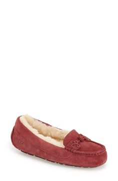 A braided-knot detail accents this cozy UGG Australia slipper.