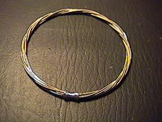 Making A Bracelet Out Of Used Electric Guitar Strings