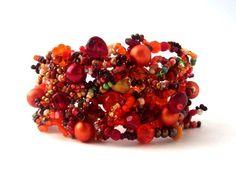 Beaded jewelry, Orange red bracelet cuff, freeform peyote beaded bracelet, Beadwork, Seed bead jewelry. $75.00, via Etsy.