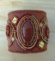Tan leather bead embroidered cuff by suegoodebeads on Etsy, $99.00