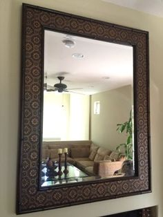 BRONZE AND GOLD COLOR ENTRYWAY OR MANTEL MIRROR WITH BAMBOO FRAME, RAISED FLOWER MOTIF AND BEVELED MIRROR. MEASURES 42X54 INCHES. THERE ARE SOME STRESS LINES IN ALL FOUR CORNERS, OTHERWISE GOOD CONDITION