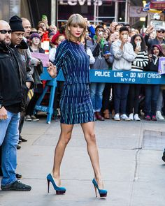 Taylor goes 1989-glam by mixing electric blue with metallic details.   - Seventeen.com