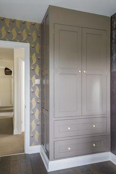Bespoke painted wardrobe with ceramic handles.