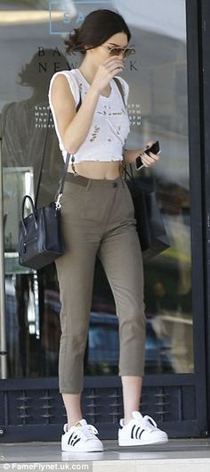 Stepping out in style: Kendall proved she knows how to make a casual ensemble look almost chic, despite a ripped tee and trainers