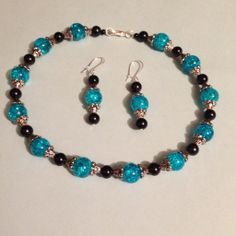 Blue sparkle with black pearls set