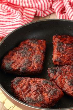Vegan Steaks nicely charred and browned in a frying pan.