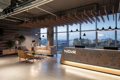 Office Tour: Nova Measuring Instruments Offices – Rehovot – Creative Home Office Design Workspace Design, Home Office Design, Office Entrance, Entrance Halls, Modular Lounges, Office Pictures, Cove Lighting, Measuring Instrument, Waiting Area