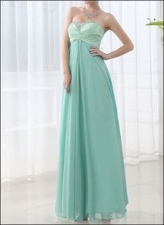 Classic elegance with a modern twist... a gorgeous empire gown made of mint green chiffon and satin. A sophisticated and stylish look for your dinner date or visit to the opera!
