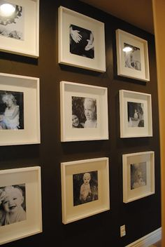 white frame. white mat. black and white pictures. contrasting wall.