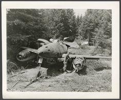 American soldier examines a Messerschmitt Me 262.