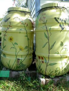 Making rain barrels beautiful - rain barrels can be very helpful for any organic garden - or any home for that matter. Here are some ideas for making those blue barrels look even more wonderful!