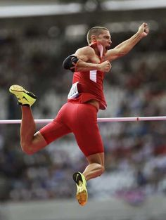 Trey Hardee of the U.S. reacts as he clears the bar in the pole vault segment of the men's decathlon competition.