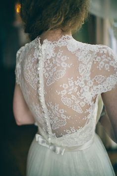 Delicate lace low back with buttons and ribbon bow - Image by LifeLine Photography - Bridal Inspiration Shoot At Prestwold Hall With Gowns By Lusan Mandongus And Eliza Jane Howell From The Wedding Shop Nottingham With Images By Lifeline Photography And Styling By Mad Philomena