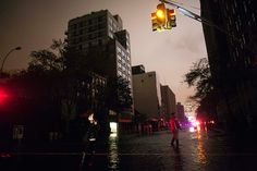 Sandy hits New York: People take photos on flooded street during blackout in Chelsea