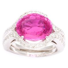 Tanagro Pink Sapphire and Diamond Ring | From a unique collection of vintage cocktail rings at http://www.1stdibs.com/jewelry/rings/cocktail-rings/